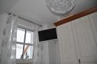 Schlafzimmer mit Doppelbett,Schrank,TV